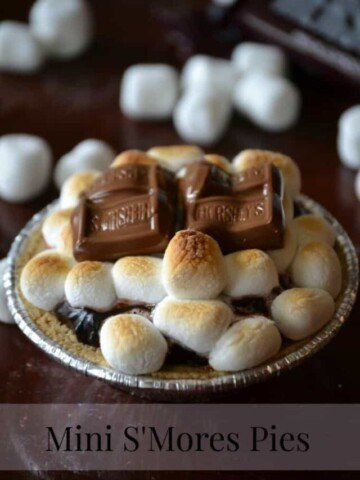 Miniature chocolate pie topped with toasted marshmallows and chocolate bars.