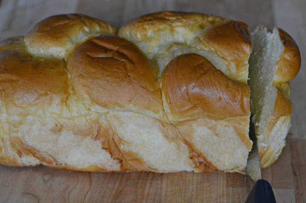 slicing brioche bread to make homemade French toast