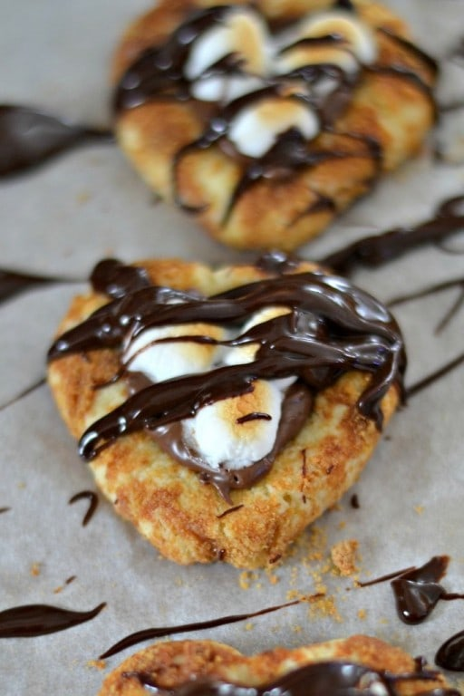 Nutella S'Mores Cookies - cute heart shaped cookies filled with Nutella and topped with marshmallows. | SouthernKissed.com