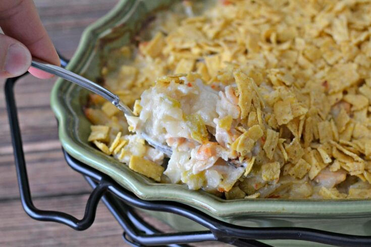This chicken casserole is super easy to throw together and your family will love it.  The dish is a satisfying blend of cheesy chicken and chiles mixed with Simply Potatoes Southwest Style Hash Browns.