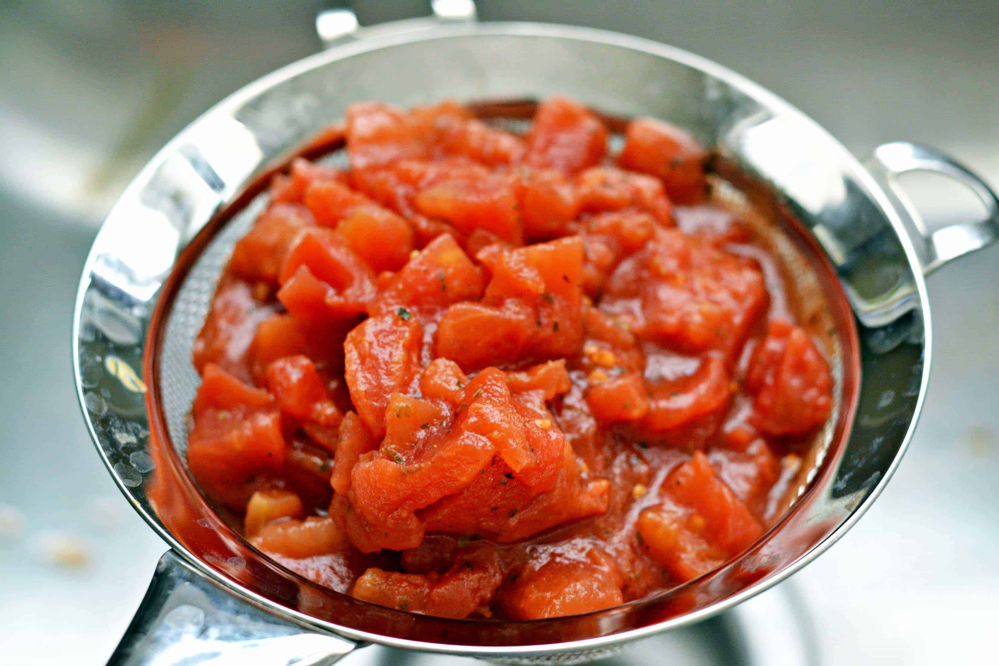 tomatoes draining in a strainer