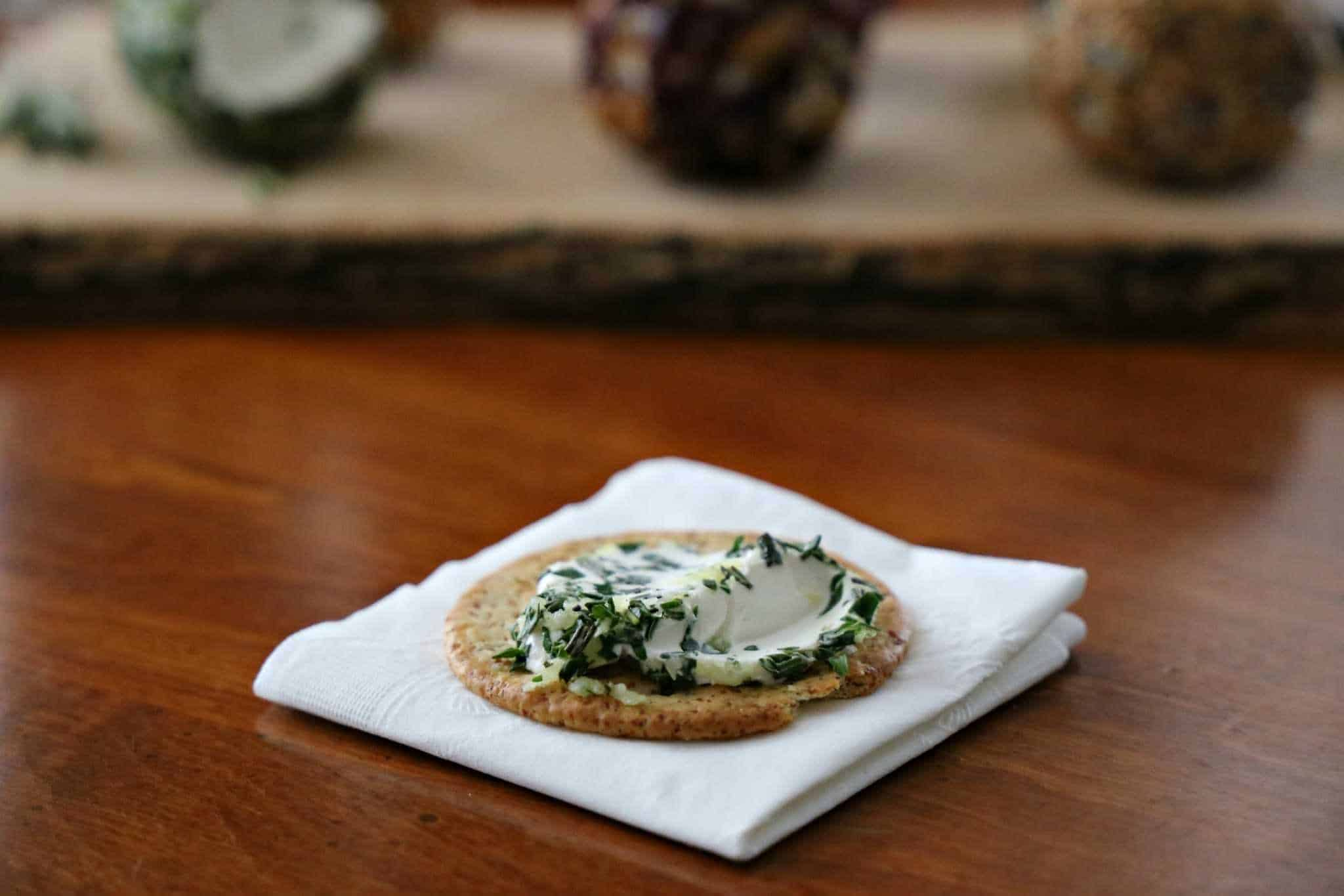 Savory mini cheeseball on cracker