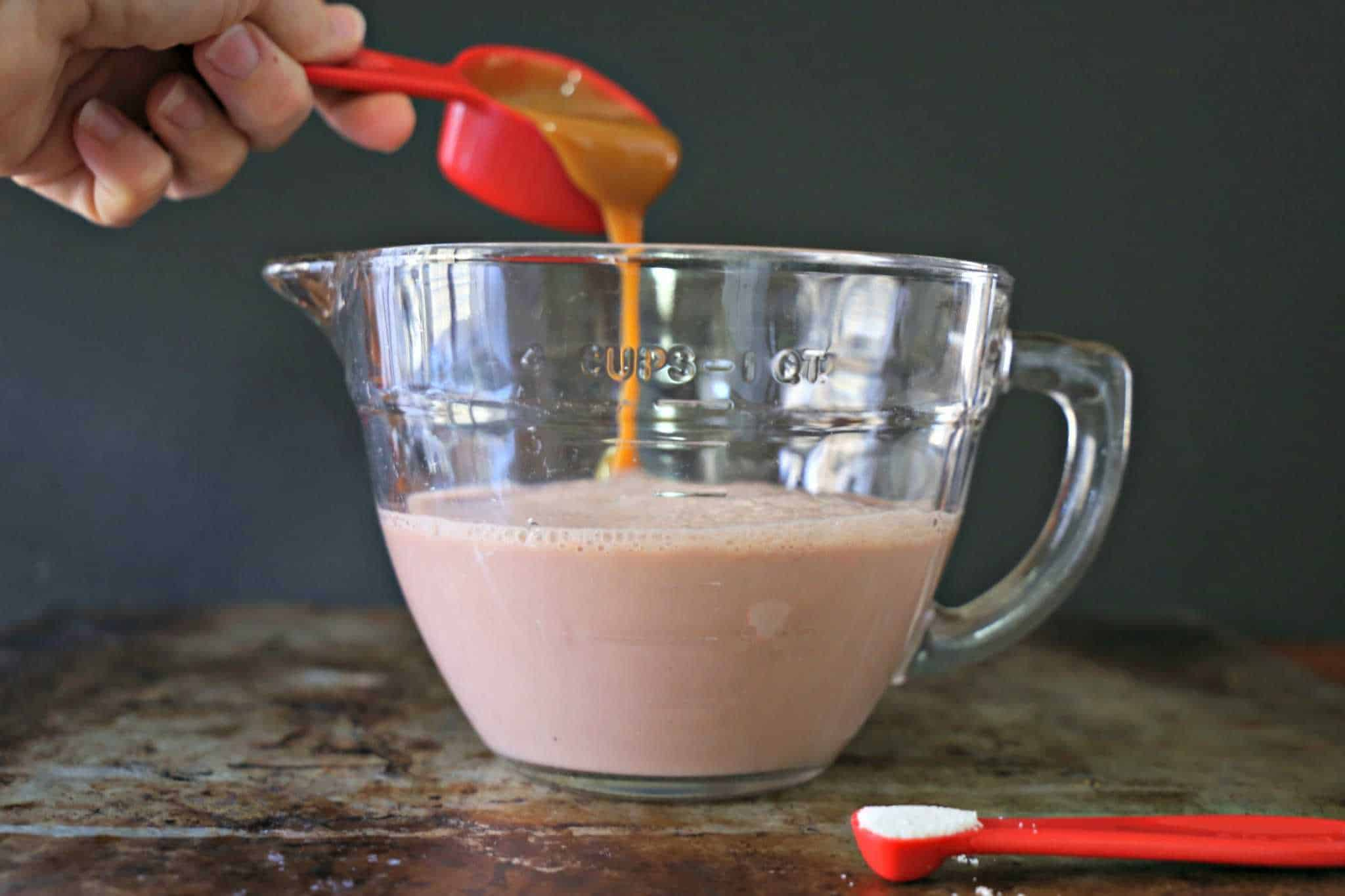 caramel being poured into chocolate milk