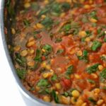 skillet with tomato dal