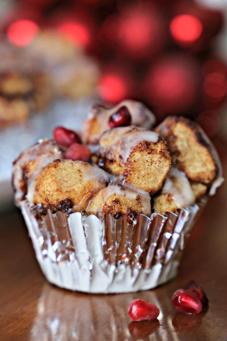 These Quick Cinnamon Roll Muffins are a twist on classic monkey bread but without all of the fuss.  They're packed with cinnamon and topped with creamy icing.