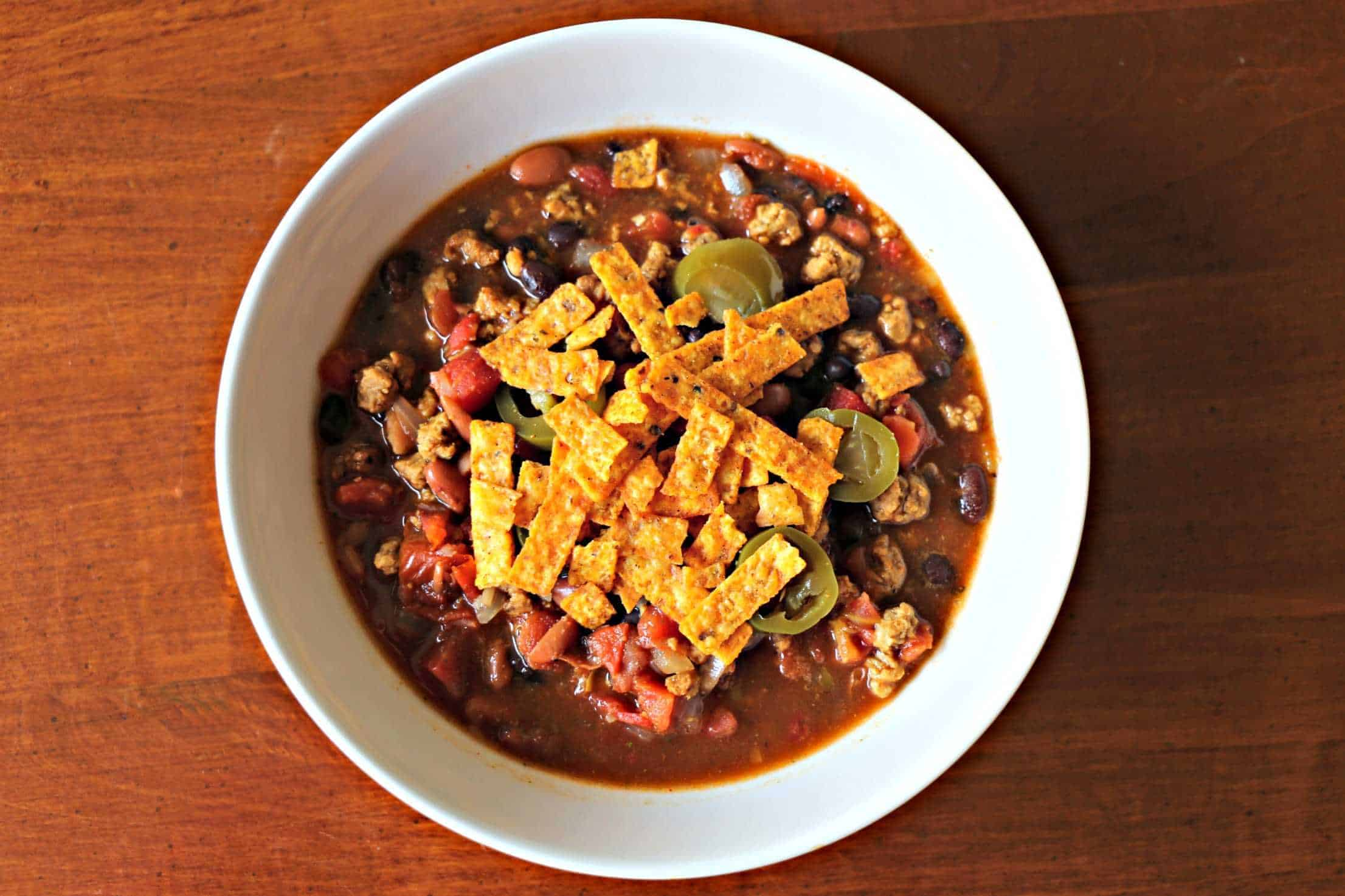 Vegetarian Taco Soup with jalapenos and crispy tortilla strips on top.