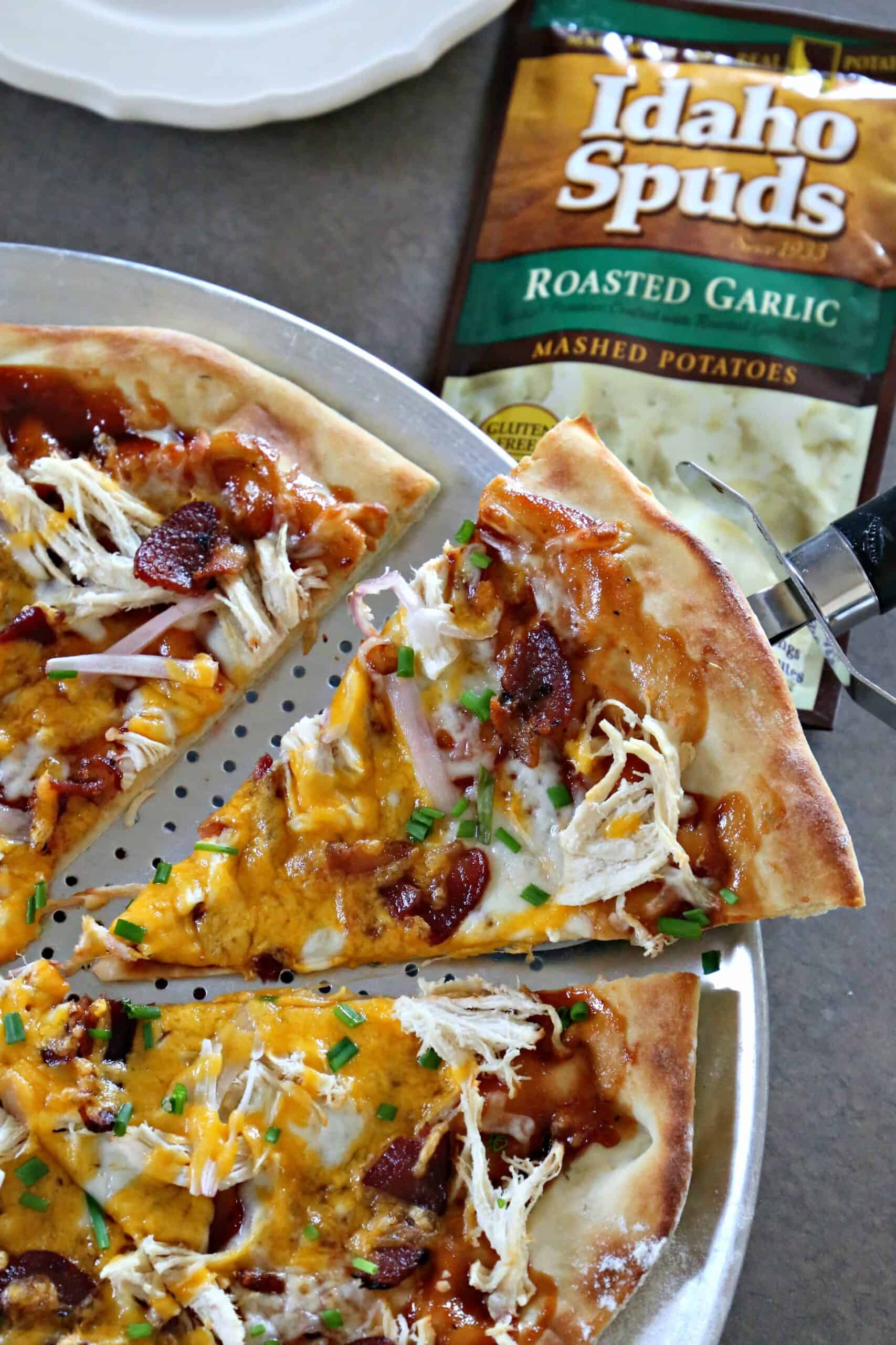 Looking for a tasty pizza recipe?  Here it is.  Made with a packet of Idaho Spuds, this Loaded BBQ Chicken Baked Potato PIZZA recipe just might change the way you make pizza from now on. #BigFlavor #CLVR