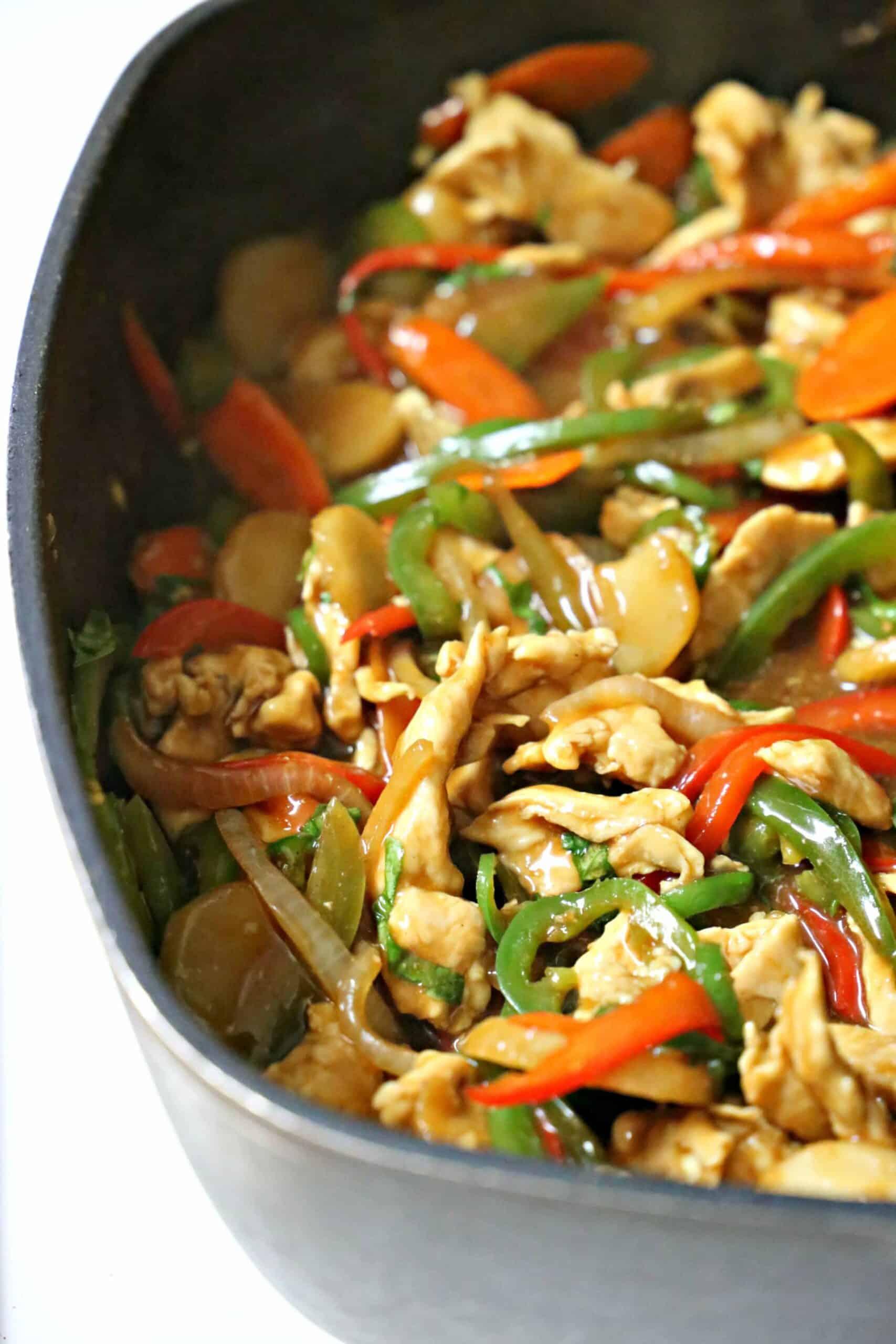 basil chicken stir-fry in a pan