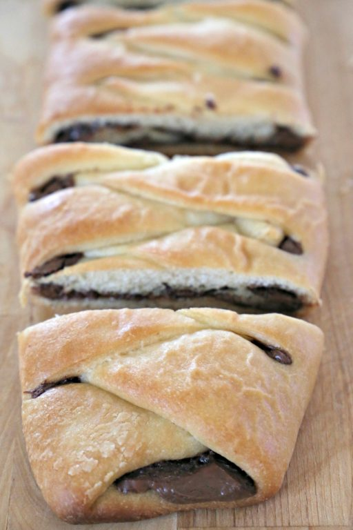 Nutella Bread, also known as Chocolate Bread, is a delicious treat any time of the day.  Rich, creamy, chocolaty  Nutella fills the center of a homemade dough.