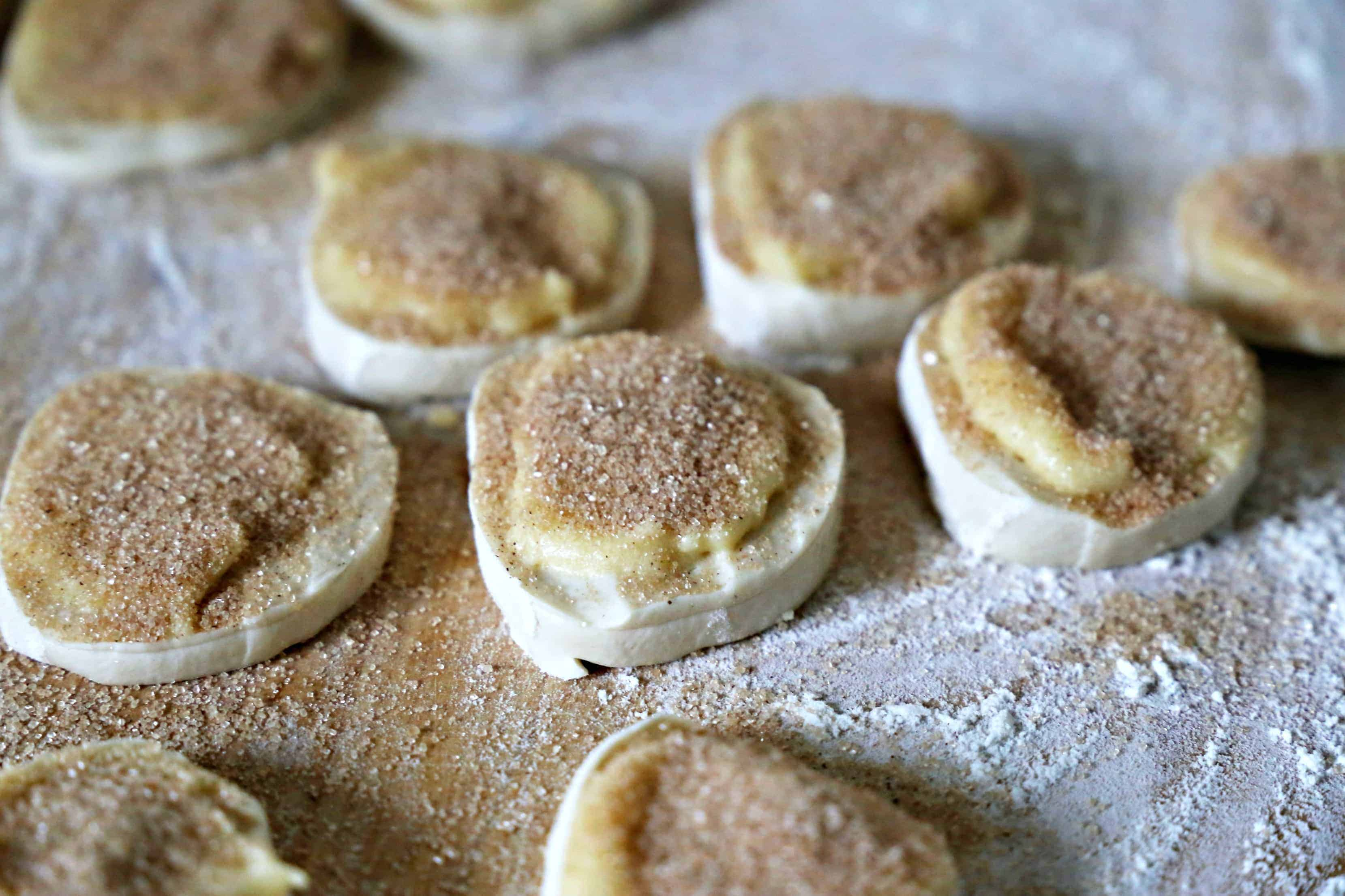 bread dough rounds with butter and cinnamon sugar