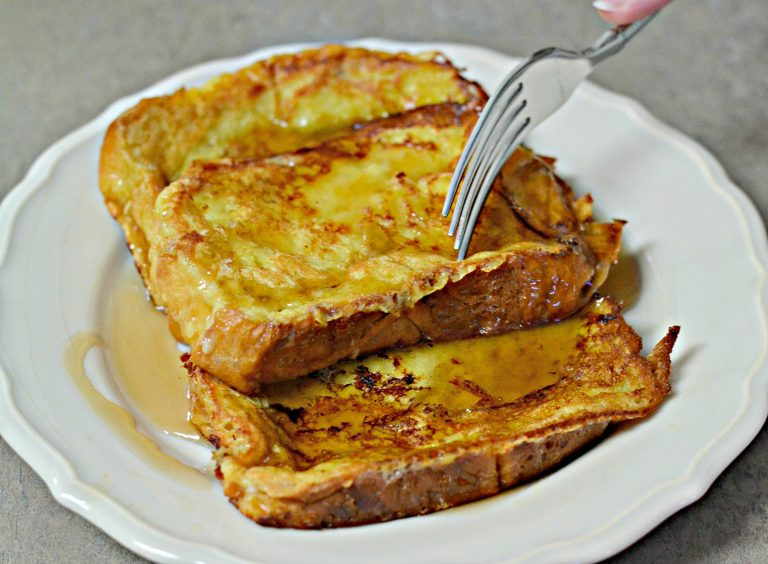 Brioche French Toast slices with maple syrup