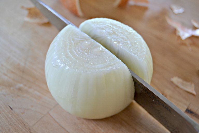knife cutting an onion