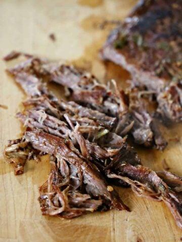 chopped carne asada on a cutting board