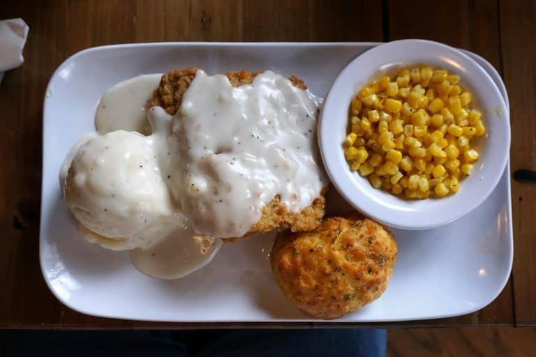Country Fried Steak Dinner with mashed potatoes, corn, and a biscuit
