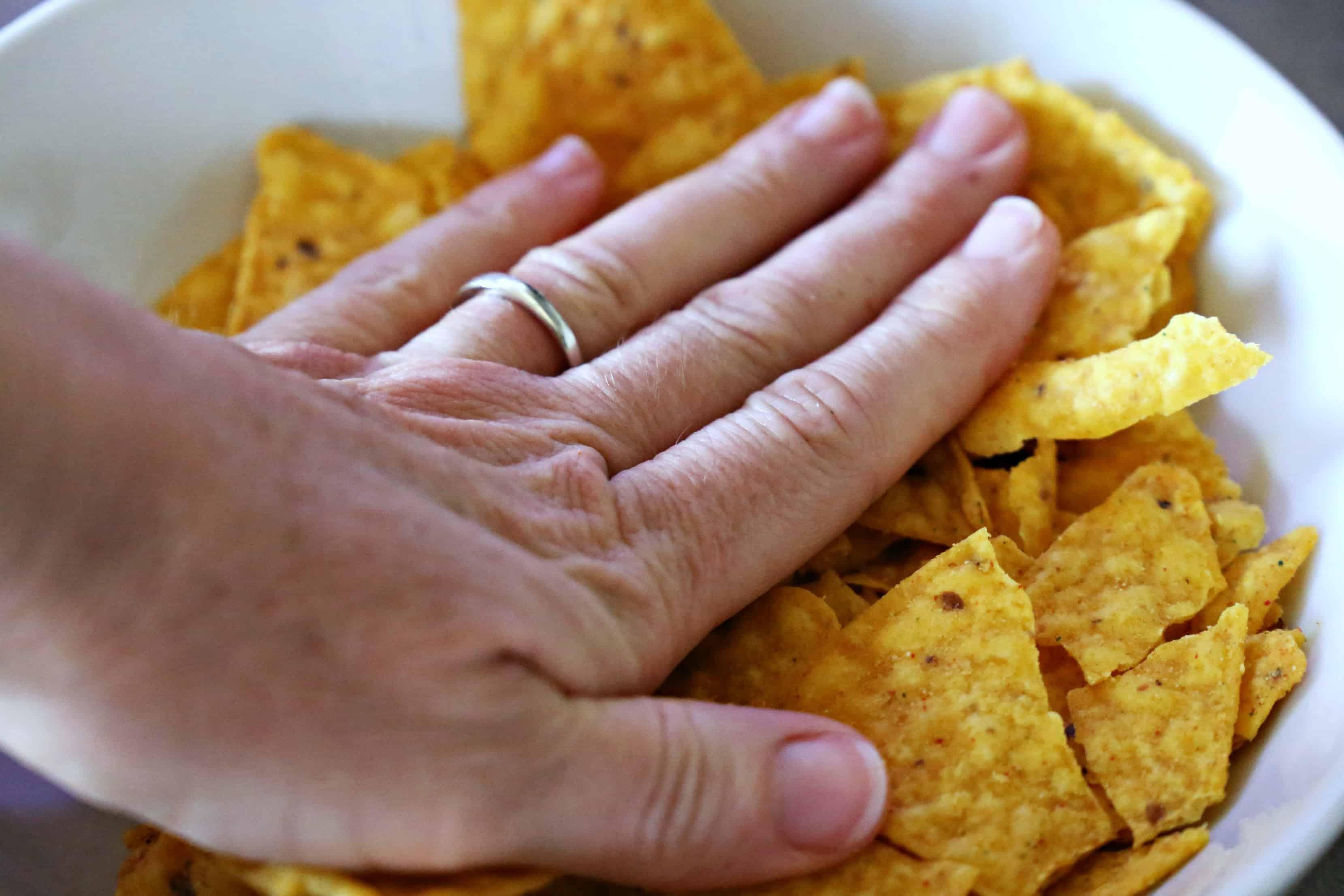 Crushing Doritos for yummy taco salad