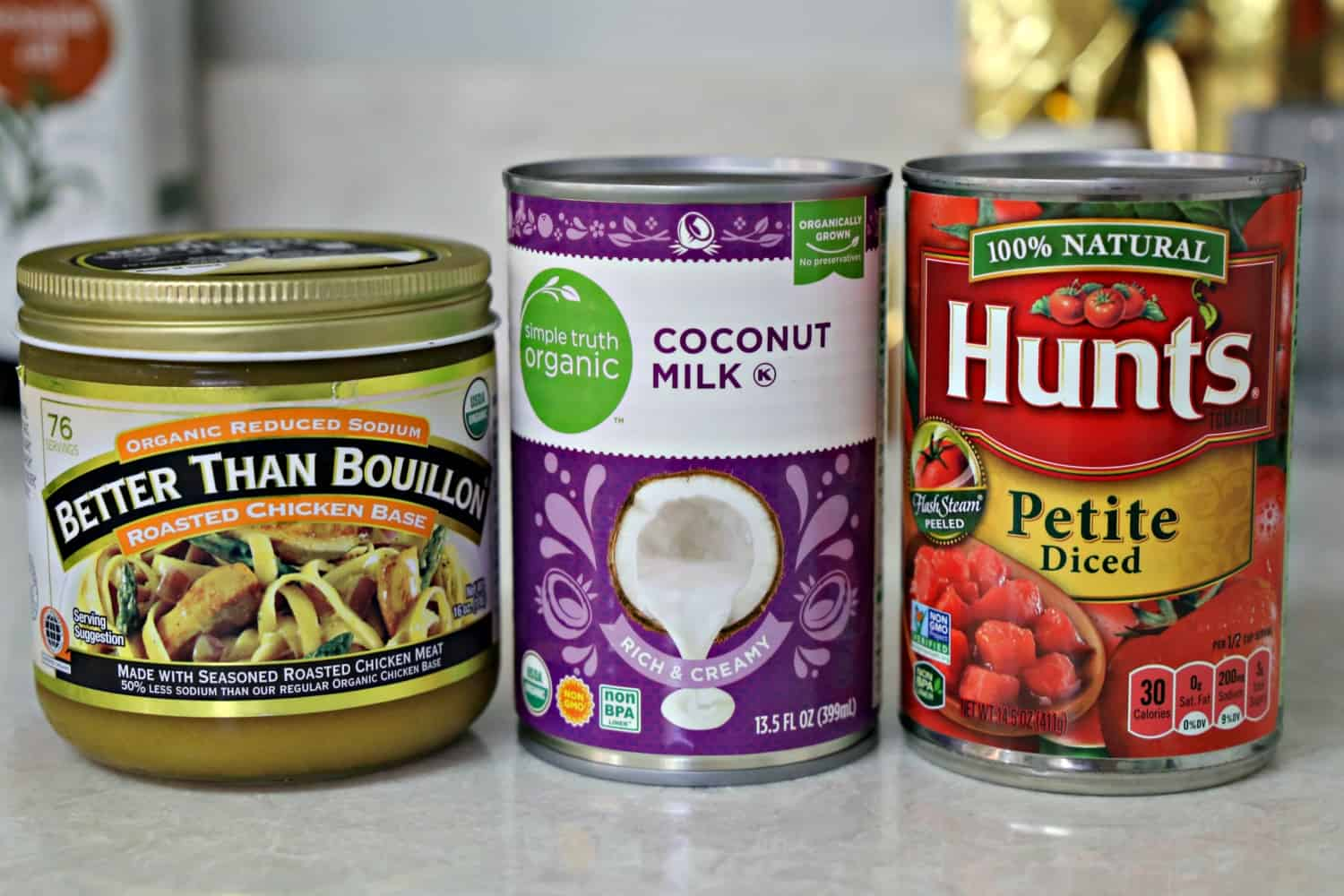 jar of Better Than Bouillon, can of coconut milk, and can of petite diced tomatoes