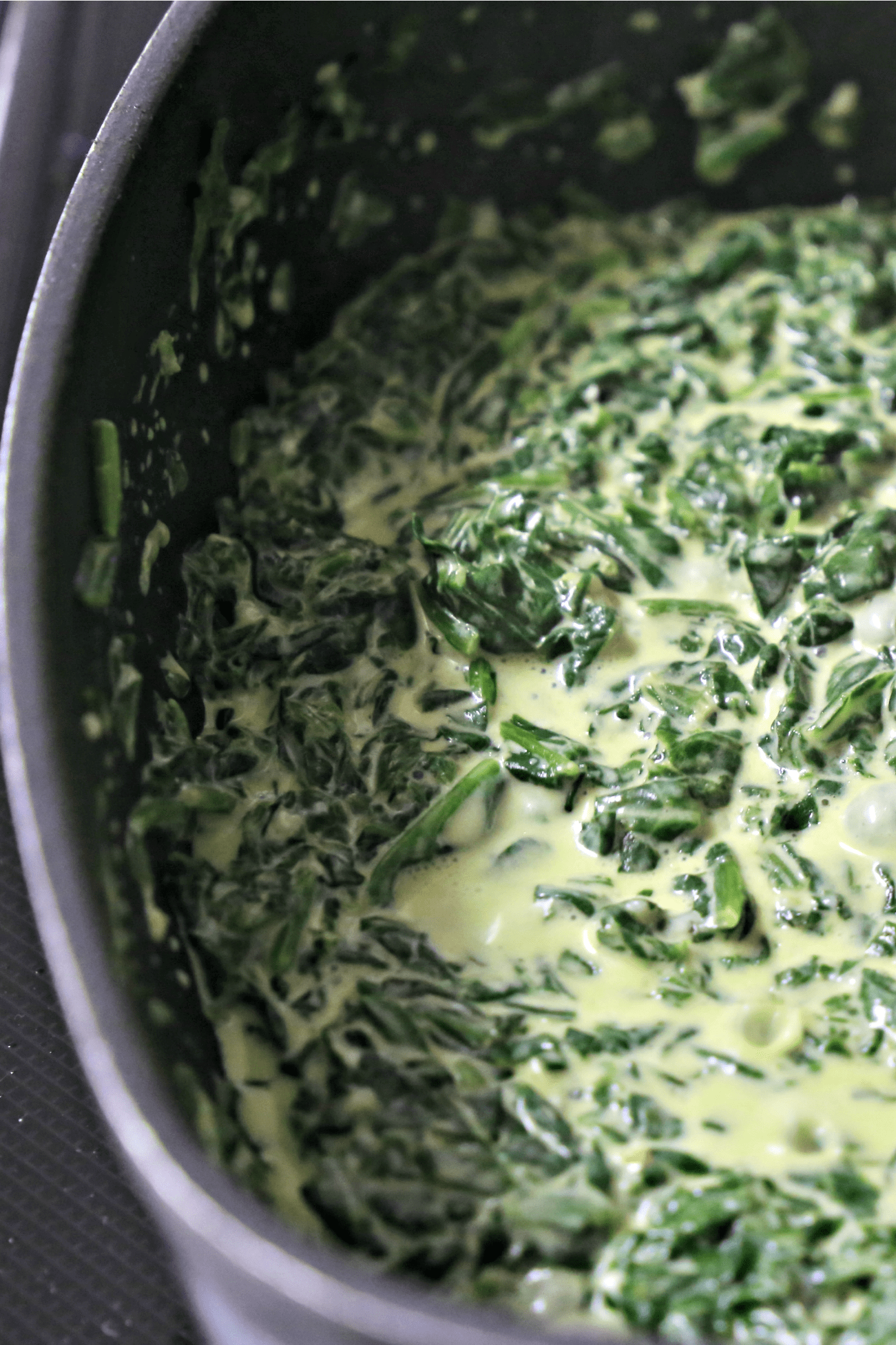 pan of creamed spinach