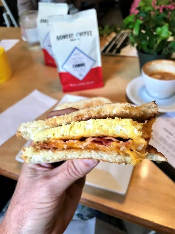 holding a breakfast sandwich