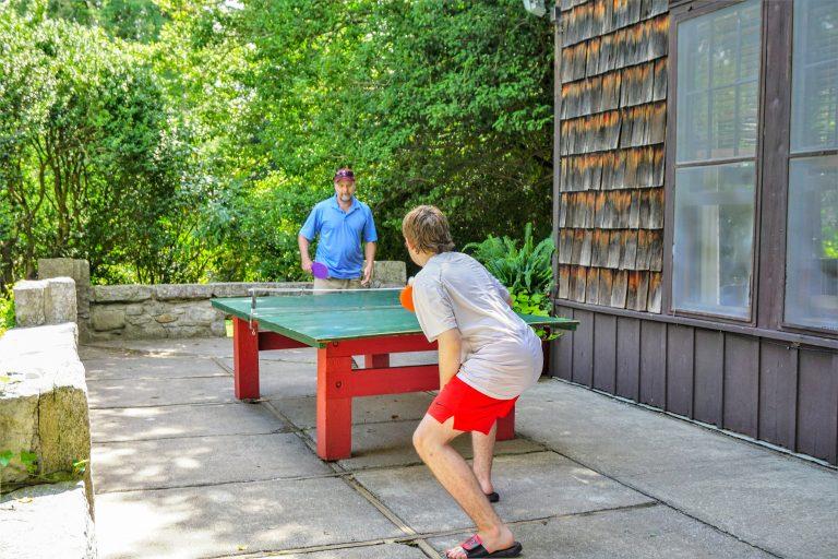 Men playing table tennis