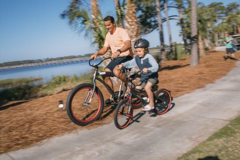 man and child bike riding