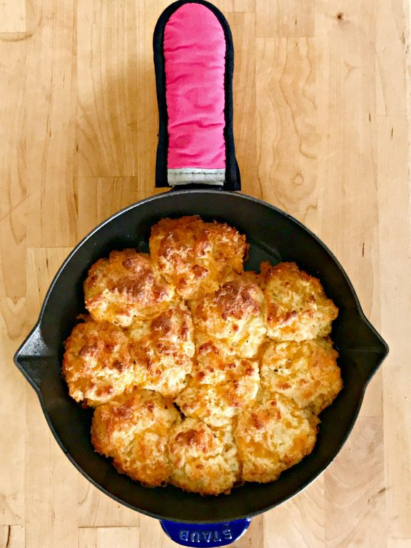 baked cheddar biscuits in a cast iron skillet