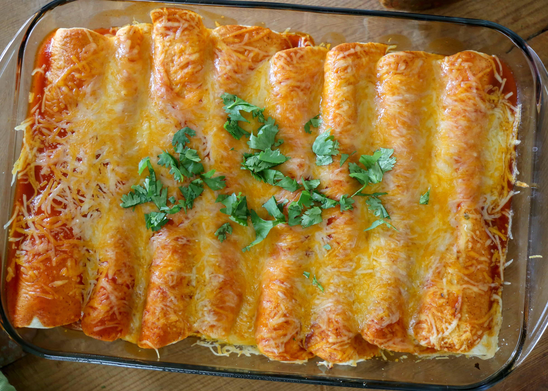 Zesty Cheesy Enchiladas in a pan