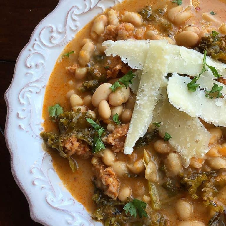 White Bean and Spicy Sausage Soup topped with Parmesan cheese