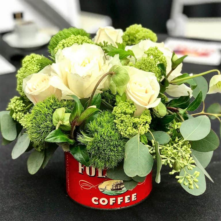 antique can of Folgers coffee with flowers