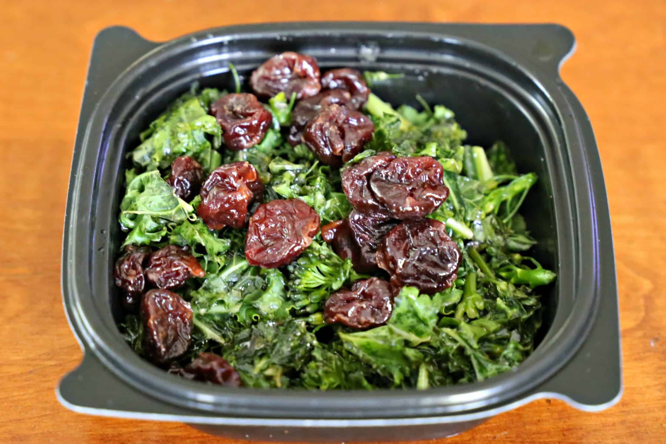 Superfood side made with kale and raisins in a small bowl.