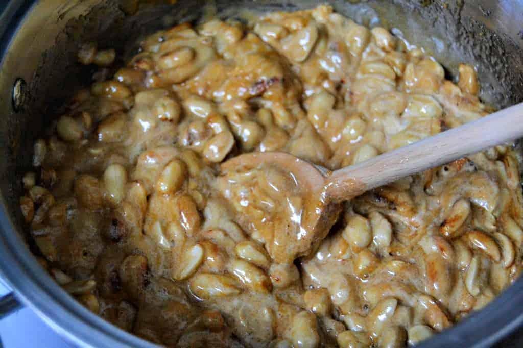 stirring homemade peanut brittle mixture
