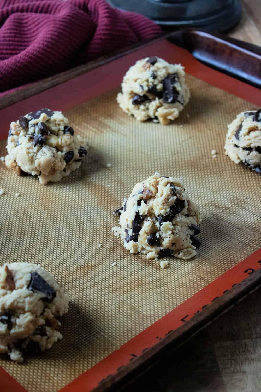 chocolate walnut cookie dough on a baking sheet