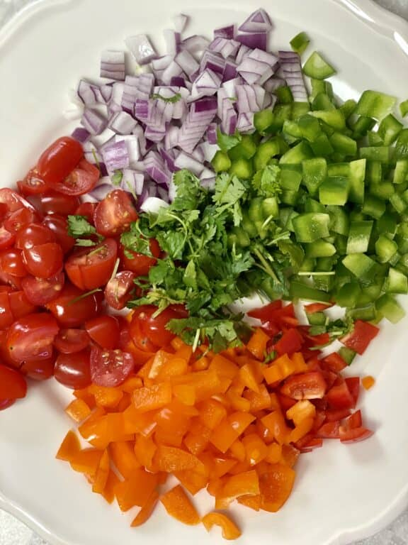 chopped bell peppers, onion, cherry tomatoes, and cilantro