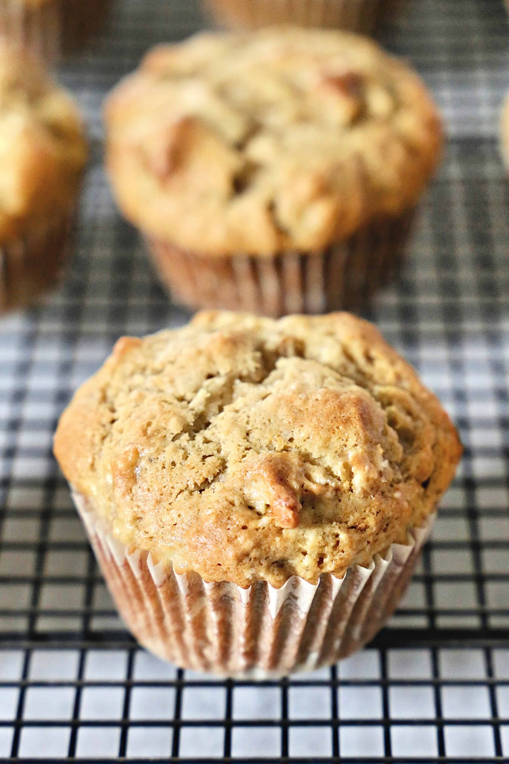 banana nut muffins on a wire rack