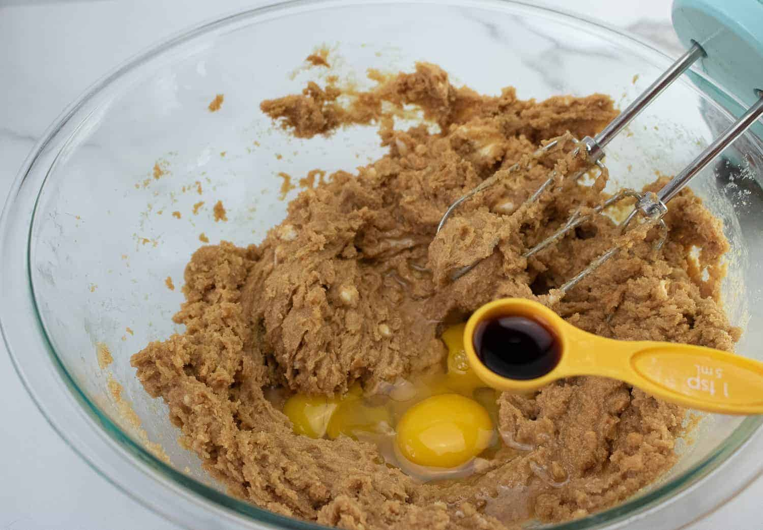 adding egg to peanut butter cookie dough