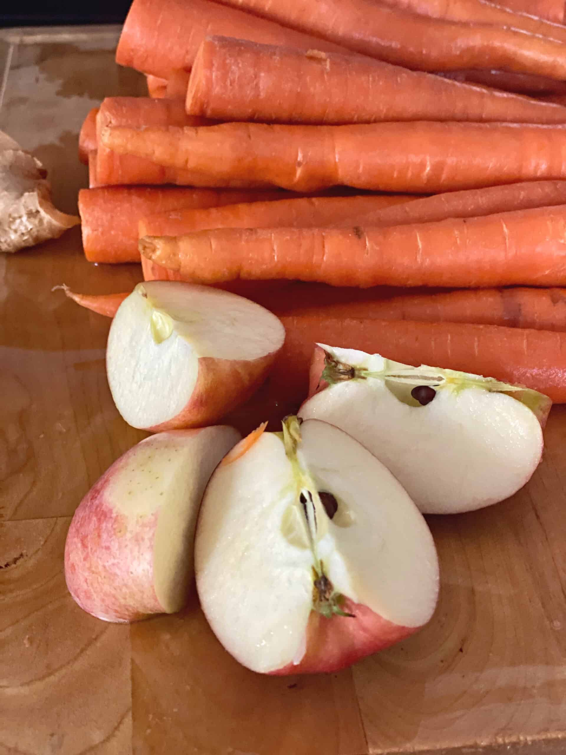 carrots and apples on a cutting board