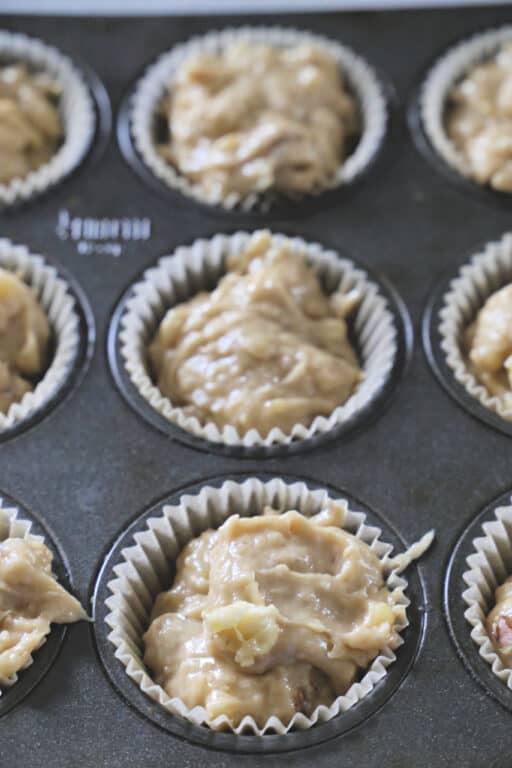 banana nut muffin batter in muffin pan