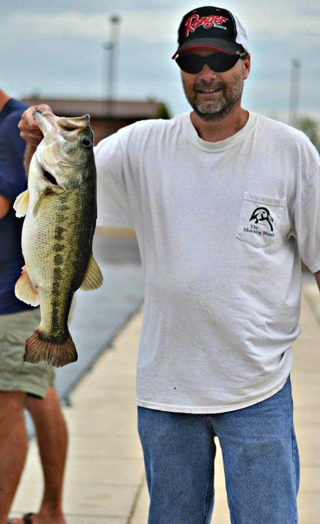 man holding a large mouth bass