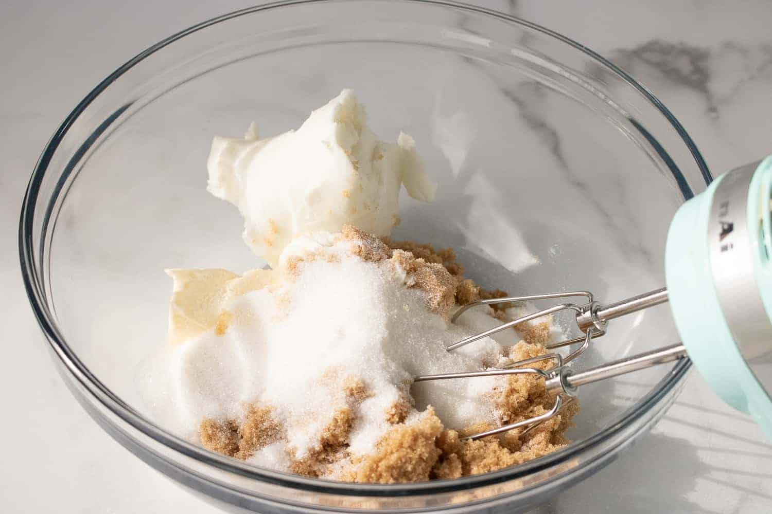 beating sugar and butter together in a bowl