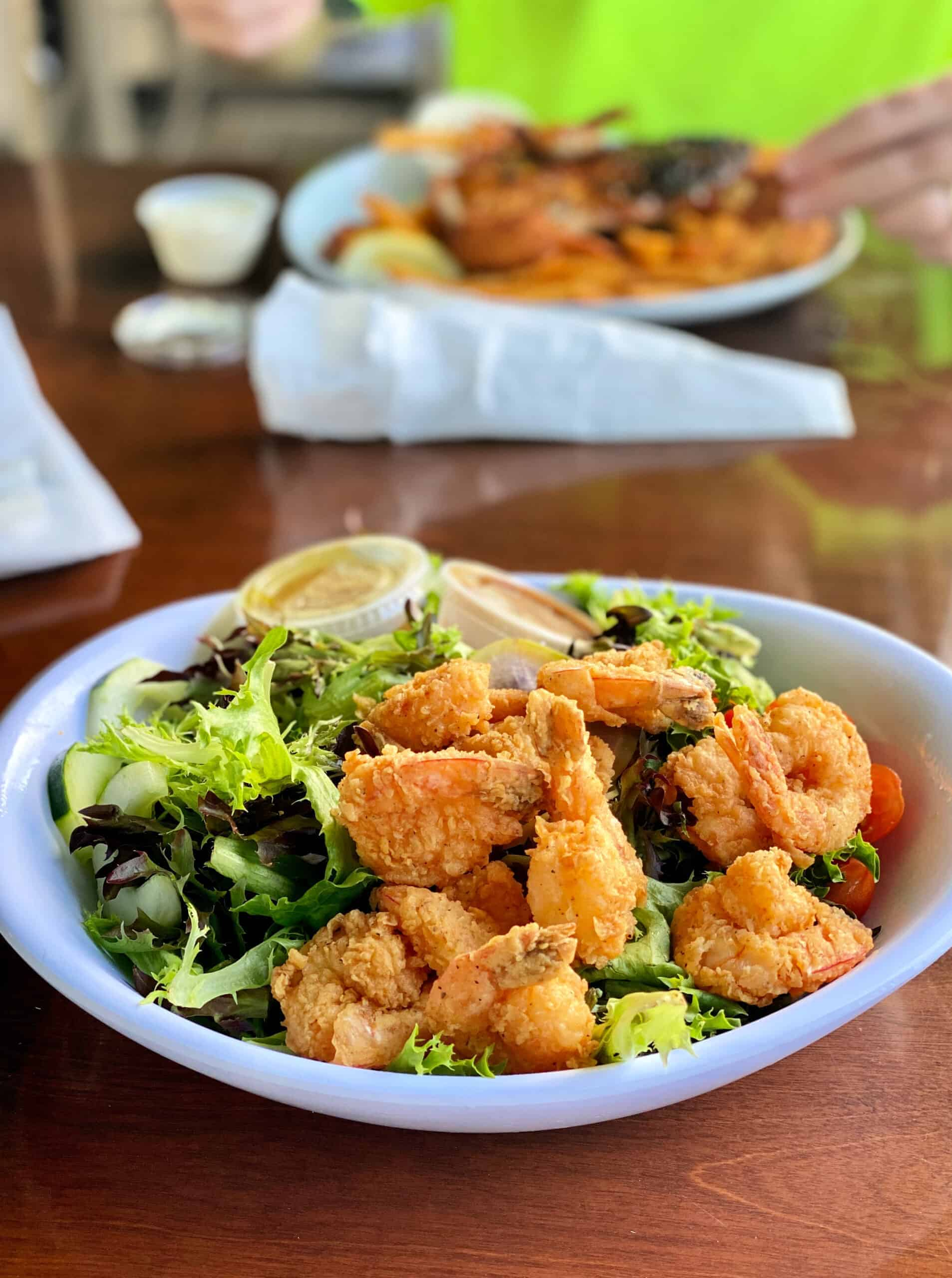 Salad bed of greens with fried shrimp