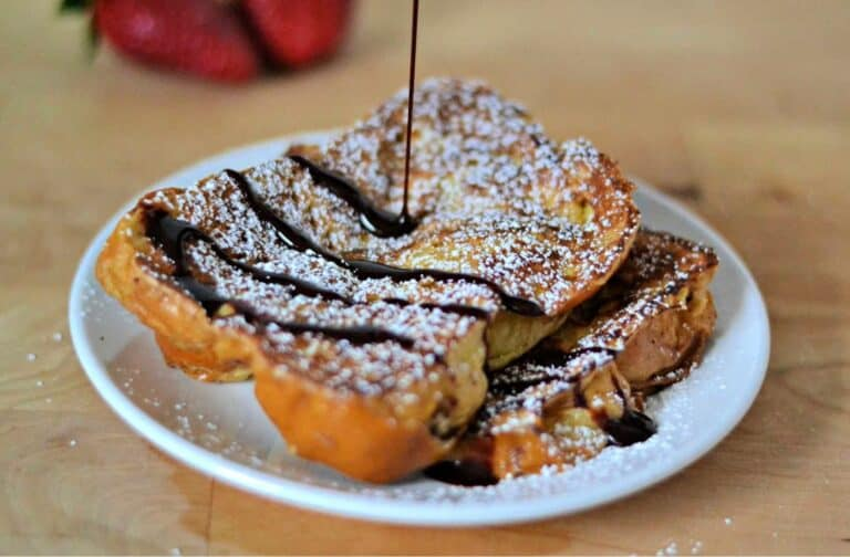 drizzling chocolate sauce on French toast