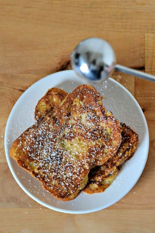 sprinkling powdered sugar on French toast