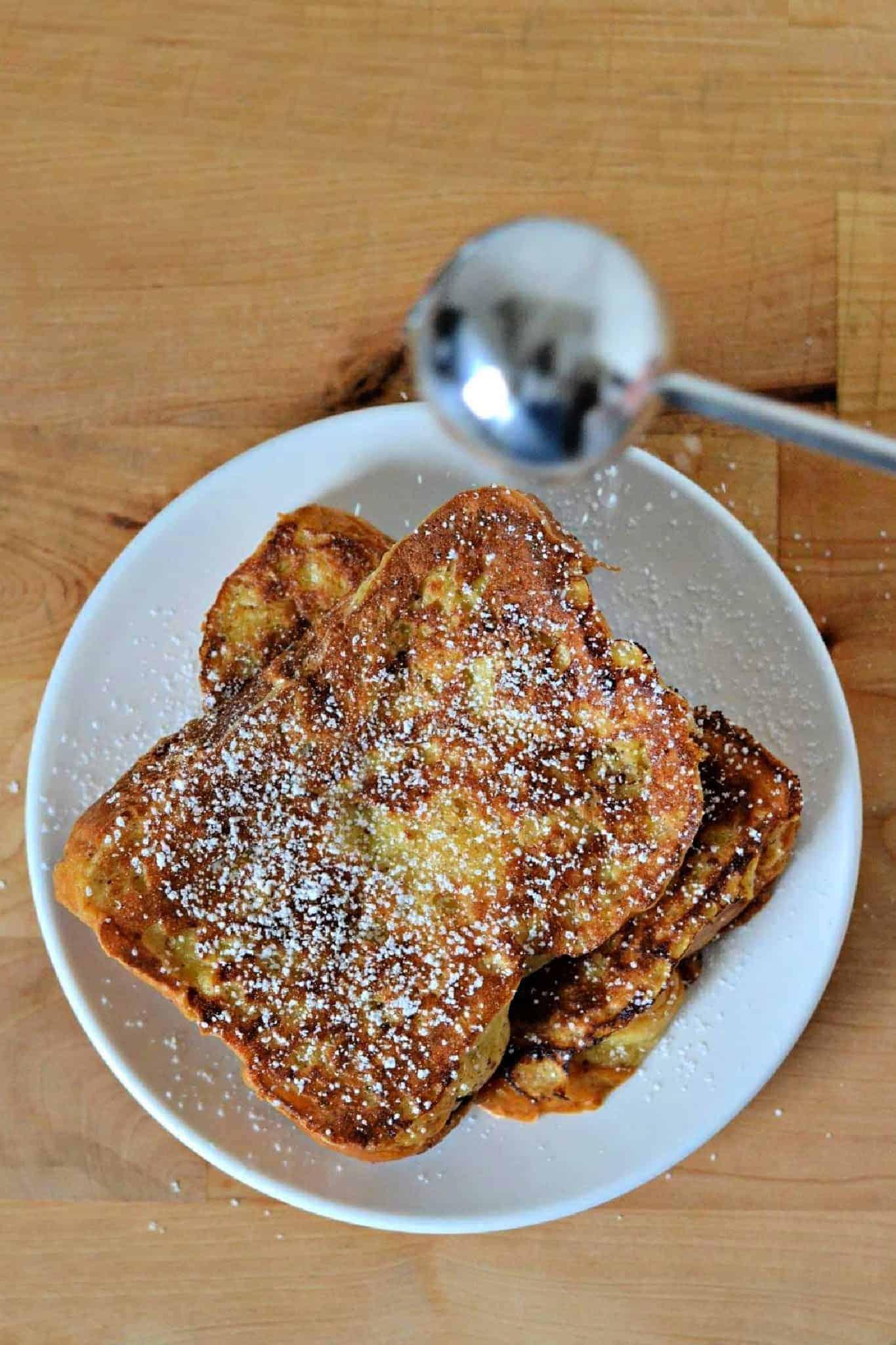 sprinkling powdered sugar on French toast
