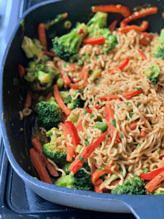 pan of ramen with vegetables and peanut sauce