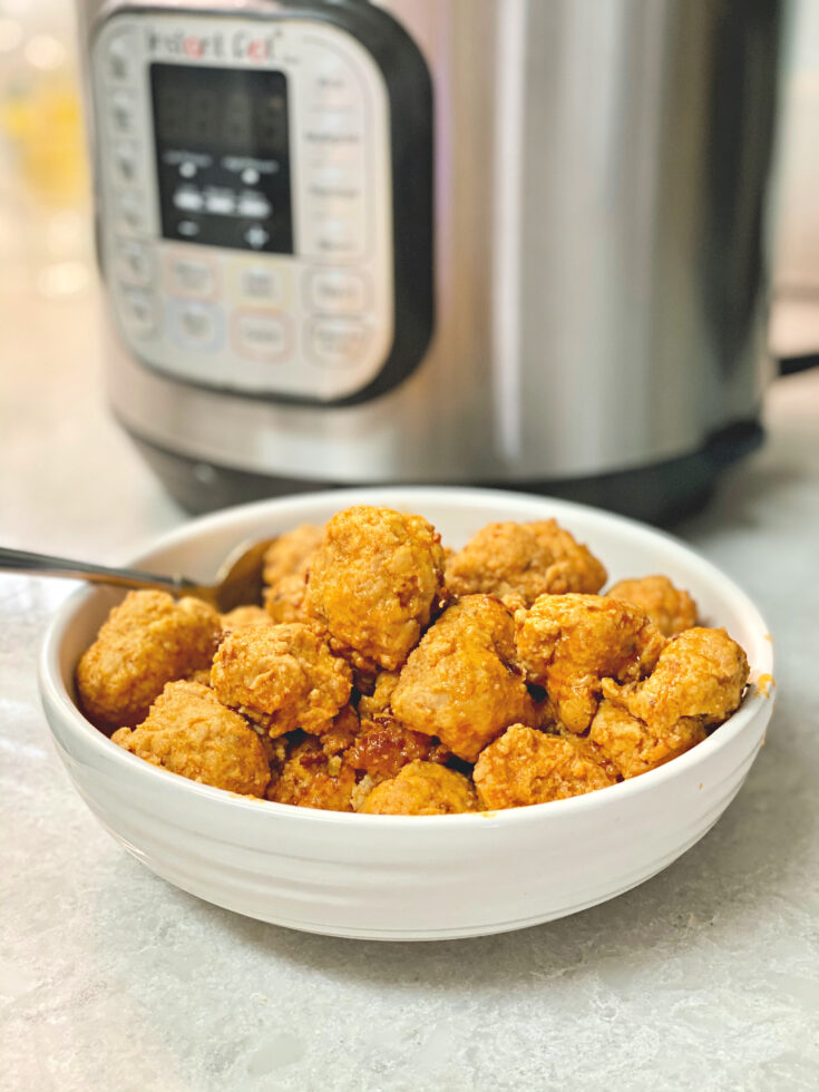 Keto Buffalo Chicken Meatballs are a great low-carb, keto-friendly appetizer made in the Instant Pot. Serve them with celery sticks and low carb Ranch or bleu cheese dressing and stay on your diet without compromising. #chickenmeatballs #lowcarb #ketoappetizer #ketorecipes