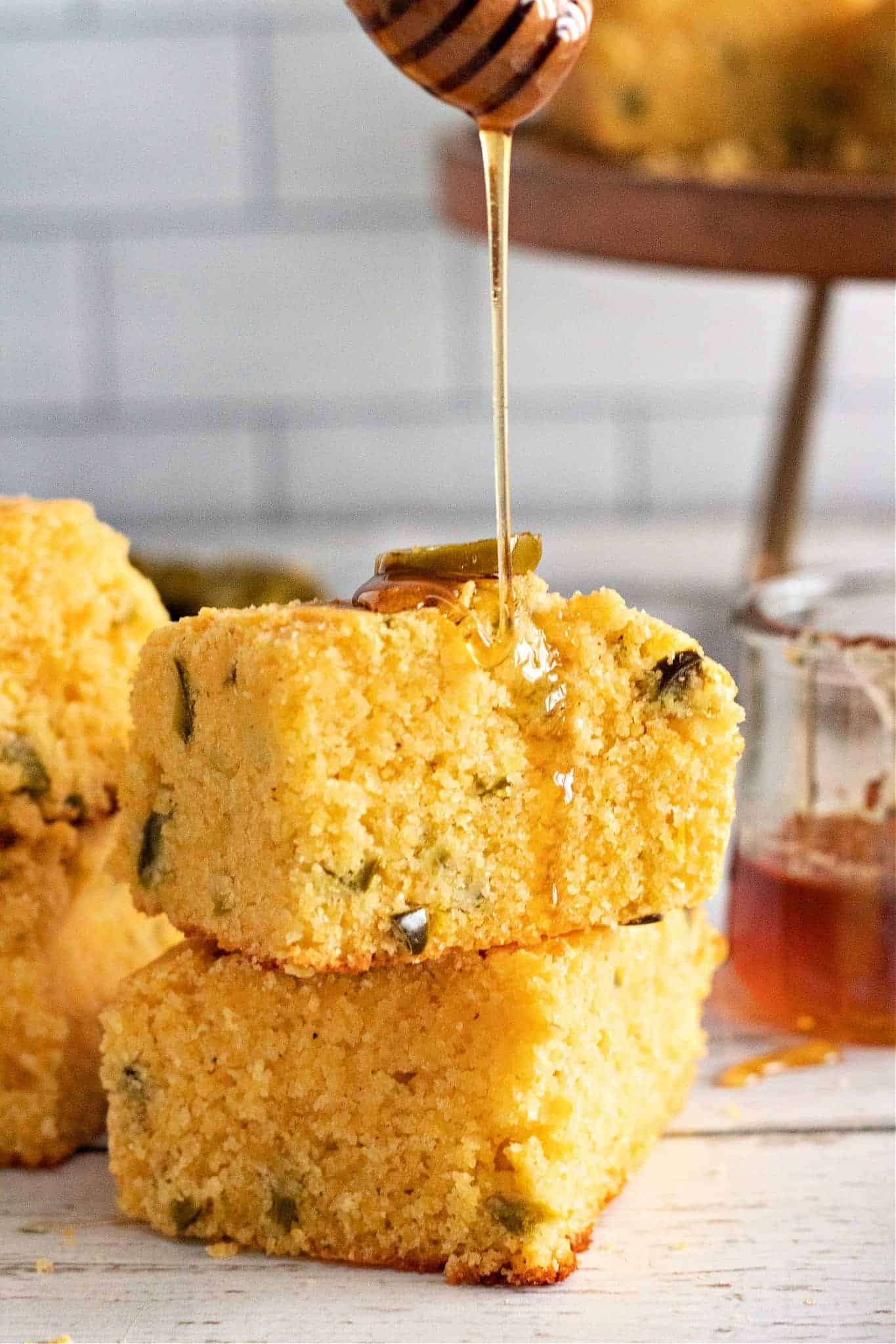 Jalapeño Cornbread with honey being drizzled on top