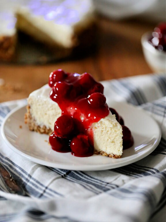 Baked Cheesecake topped with cherries