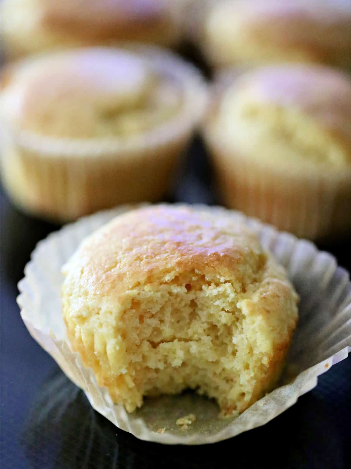 a sweet cornbread muffin with a bite taken out of it