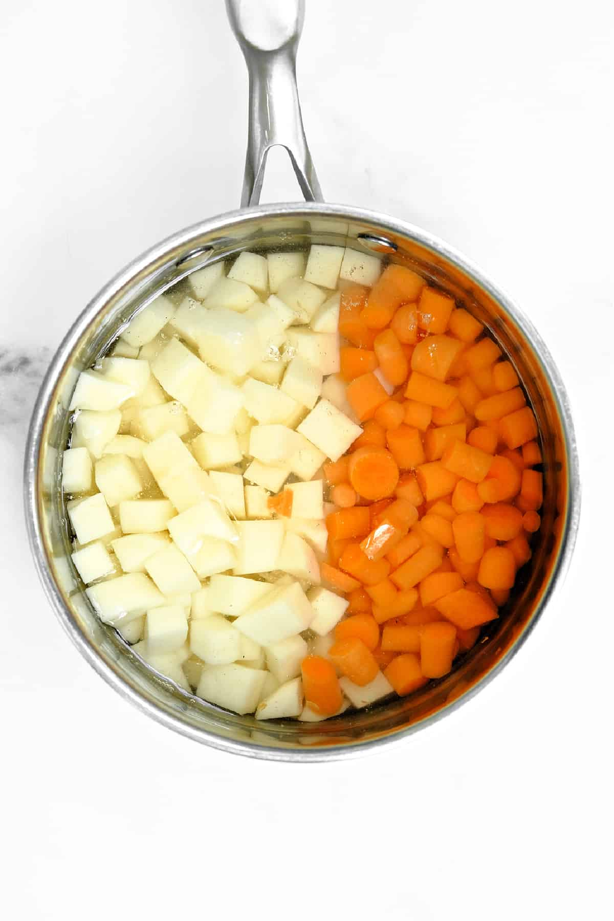 potatoes and carrots in a pot