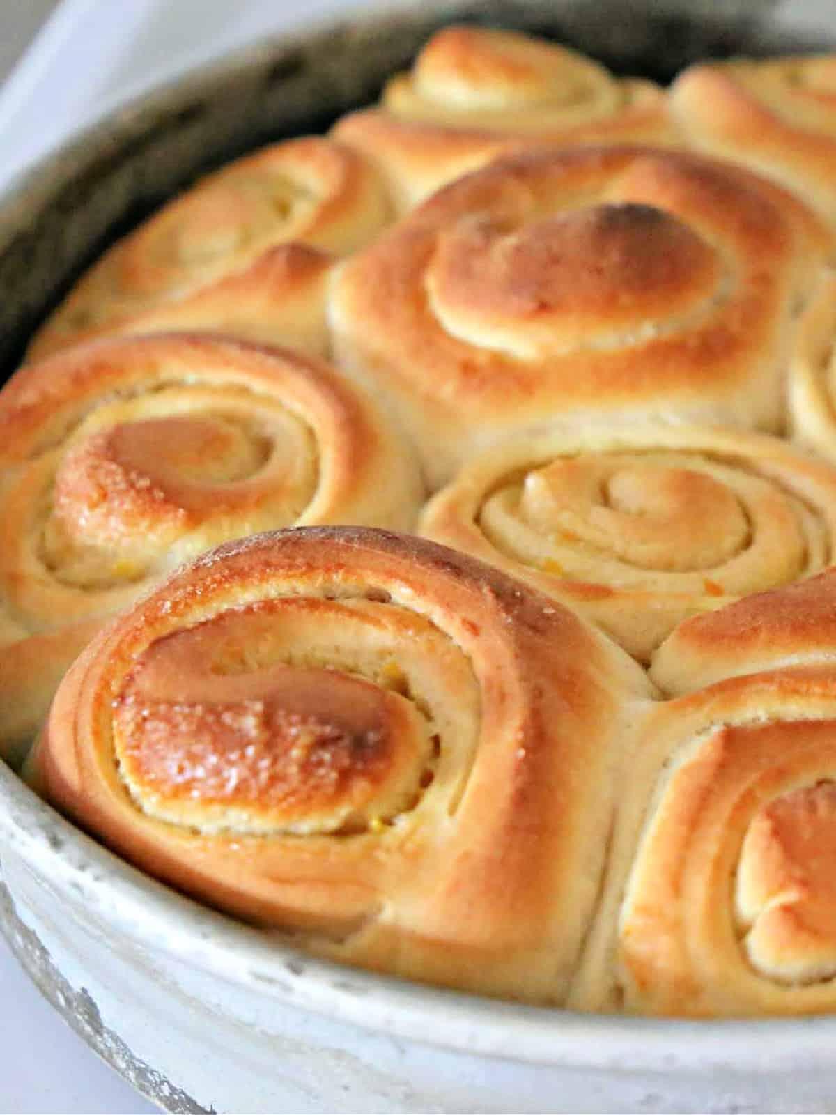 pan of baked orange rolls