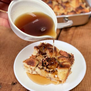 Syrup being poured on top of French toast casserole